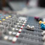 Sound mixer in professional radio broadcasting and music recording studio.